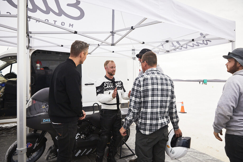 Elliott Motorcycles land speed racing team discussing the conditions in the pit area during Speed Week 2021 at Lake Gairdner in South Australia